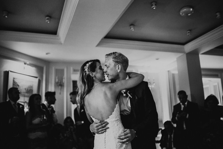 First Dance | Bride in Pronovias Oringo Lace Bridal Gown & Cape | Groom in Blue Marks and Spencer Suit | Green, White & Gold Wedding at Buckland Tout Saints, Devon |  Darina Stoda Photography