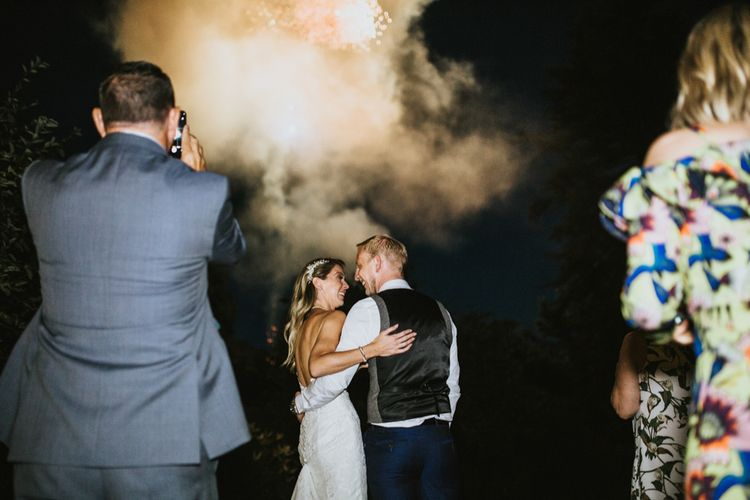 Surprise Fireworks Display | Bride in Pronovias Oringo Lace Bridal Gown & Cape | Groom in Blue Marks and Spencer Suit | Green, White & Gold Wedding at Buckland Tout Saints, Devon |  Darina Stoda Photography