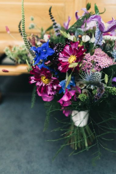 Bright wildflower bouquet to match floral moon gate arch