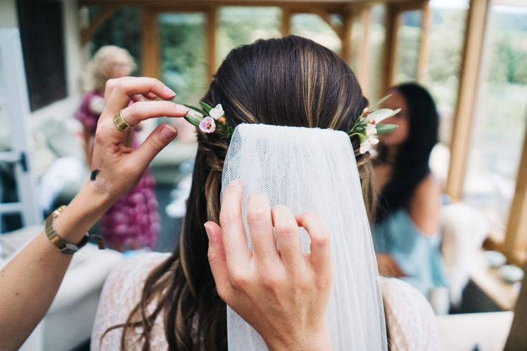 Bridal finishing touches with veil and floral hair pieces