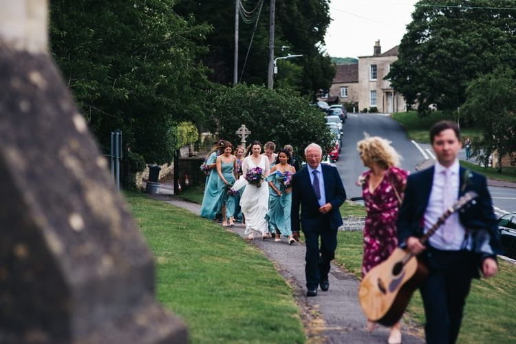Bride and bridal party arrive at church ceremony