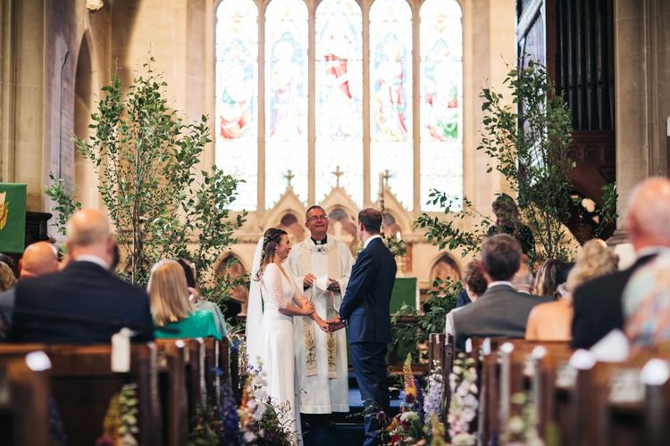 Church wedding ceremony with tree decor