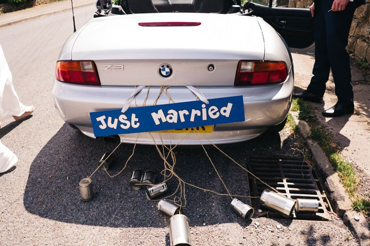 Just married sign on wedding transport