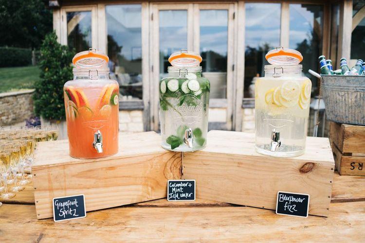 Wedding drinks in glass dispensers