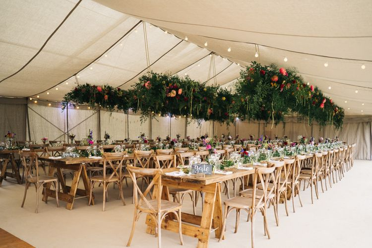 Beautiful marquee wedding with hanging flower installations