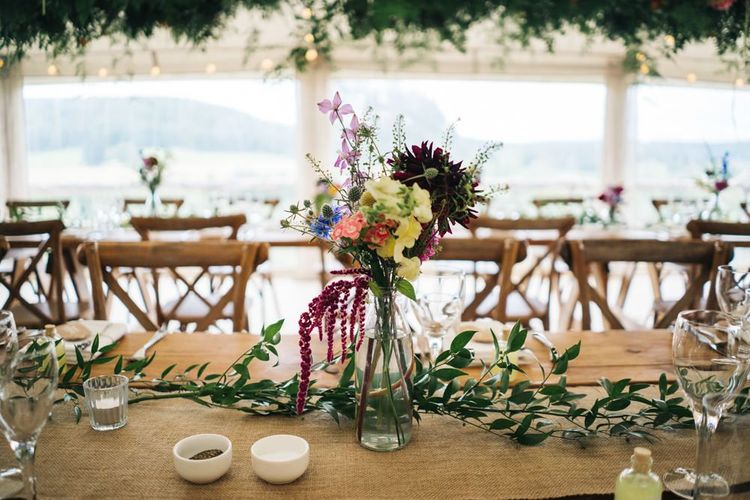 Wildflower table decor for marquee wedding matching the moon gate arch