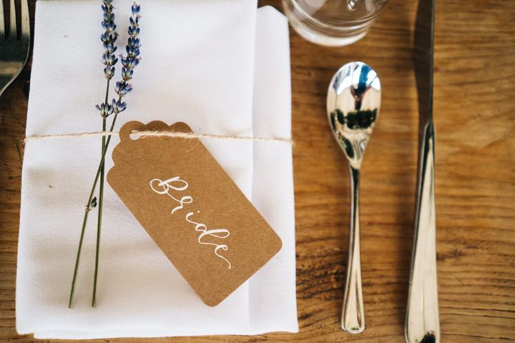 Wedding guest place setting with name tag and floral decor