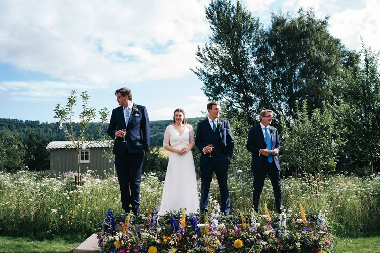 Bride and groom do wedding speeches during outside drinks