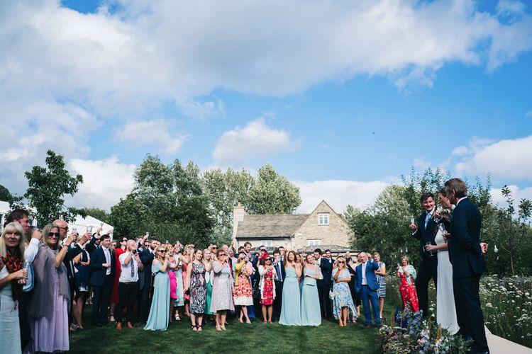 Wedding guests listen to the wedding speeches