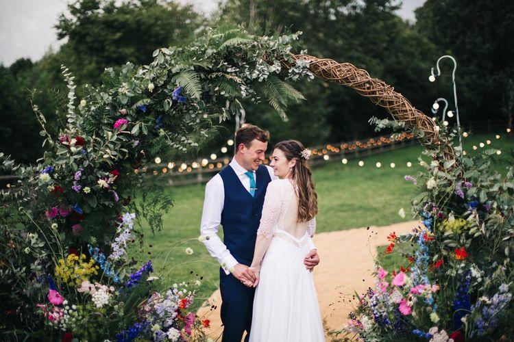 Wildflower moon gate arch at garden wedding