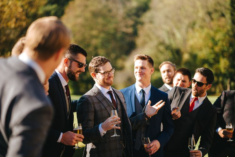 Groom in Check Christopher Schafer Clothier Suit Surrounded by his Groomsmen