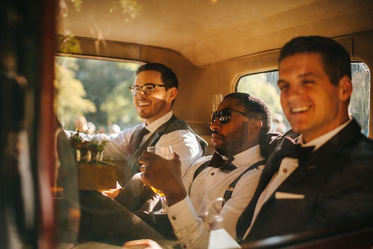 Groomsmen arriving in Vintage Wedding Car