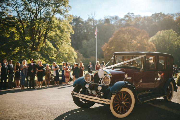 Vintage Wedding Car Arriving at Wedding Venue