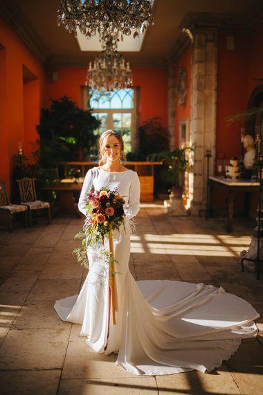 Bride in Minimalist Pronovias Wedding Dress with Front Split