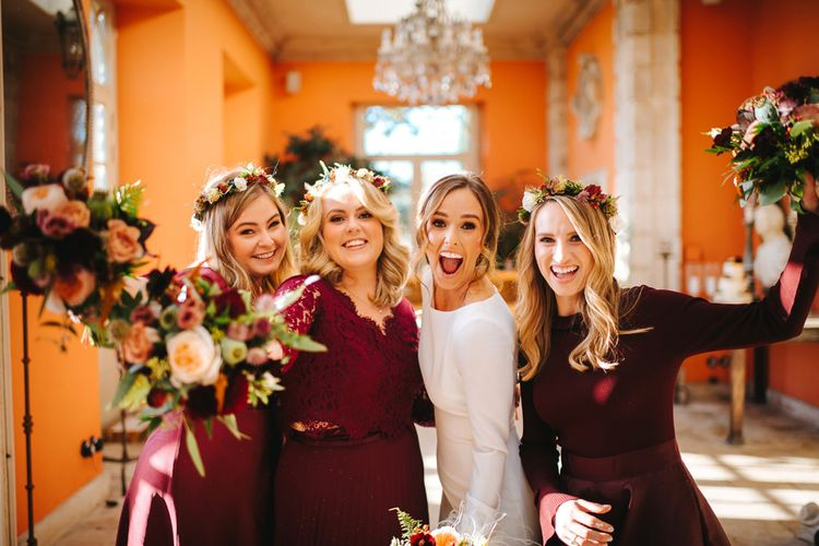Bride in Pronovias Wedding Dress and Bridesmaids in Burgundy Dresses