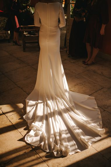 The Light Catching the Train of the Brides Pronovias Wedding Dress