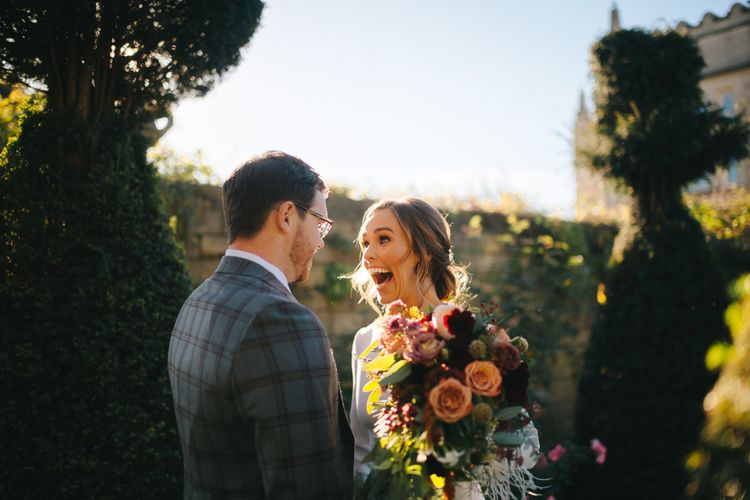 Happy Bride in Pronovias Wedding Dress and Groom in Checked Suit at Their First Look