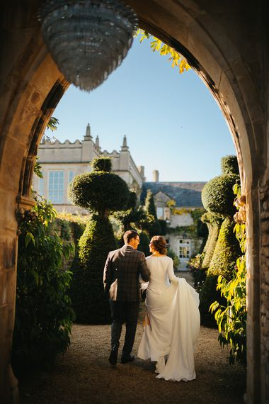 Bride in Pronovias Wedding Dress and Groom in Checked Suit