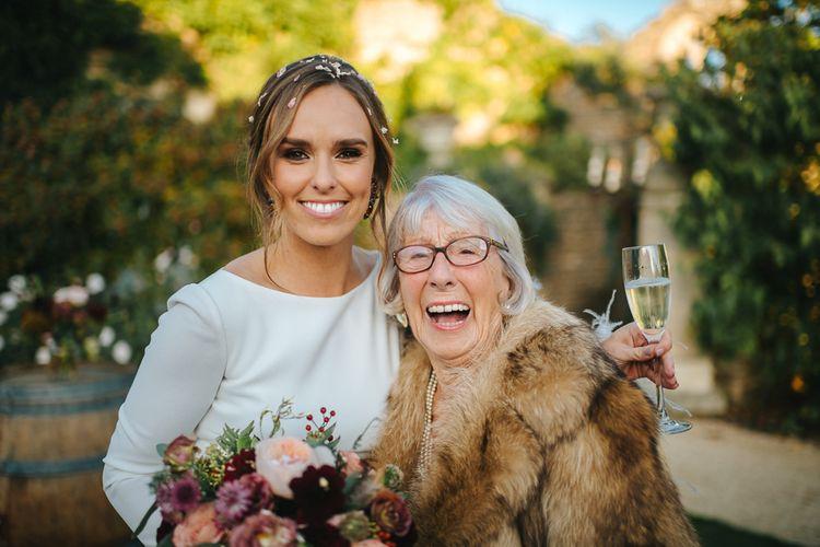 Bride in Pronovias Wedding Dress and Nan in Faux Fur Jacket