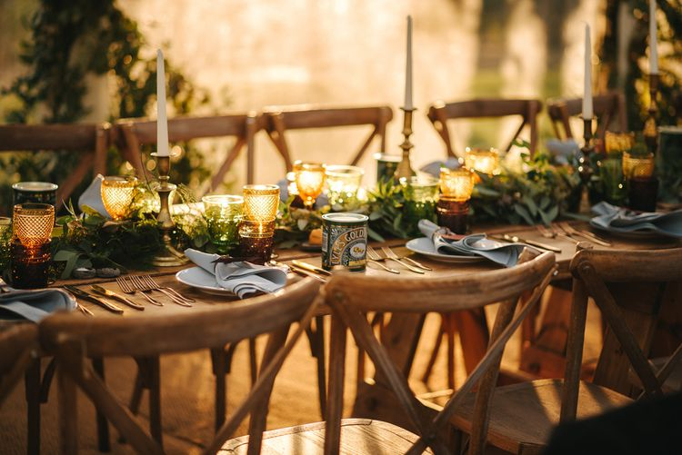 Rustic Wedding Reception Decor with Wooden Chairs , Foliage Table Runner and Yellow Goblets