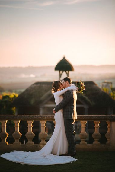 Sunset Wedding Portrait of Bride and Groom Embracing