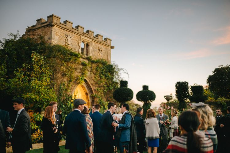 Wedding Guests Gathered in The Gardens of  The Lost Orangery at Euridge Manor