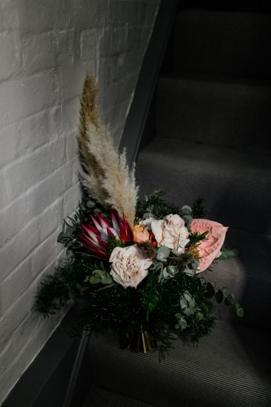 Boho wedding bouquet with king protea, pampas grass and anthuriums