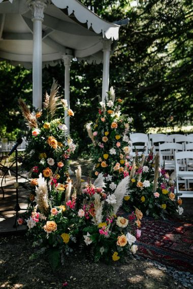 Colourful wedding floral arrangements with pampas grass