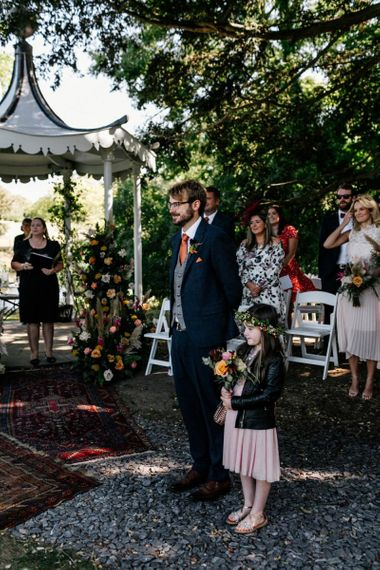 Groom and Flower Girl waiting at the Altar of the outdoor Preston Court wedding ceremony