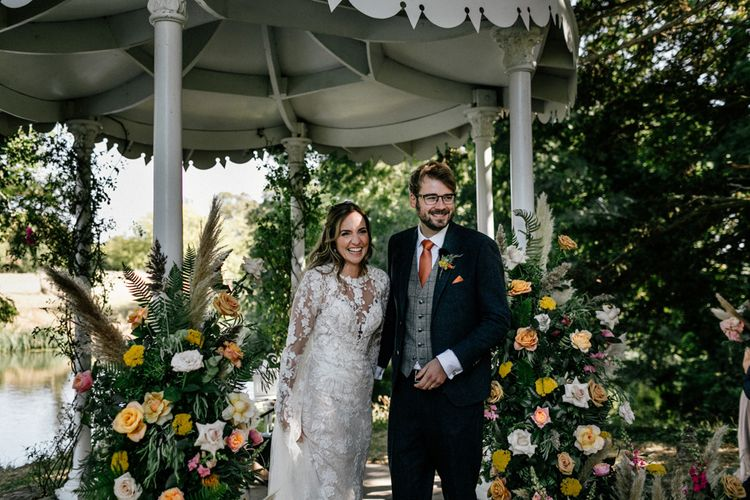 bride and groom just married at outdoor wedding ceremony