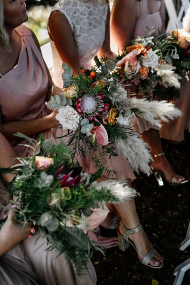 Bridesmaids Bouquets with pampas grass, roses and king proteas
