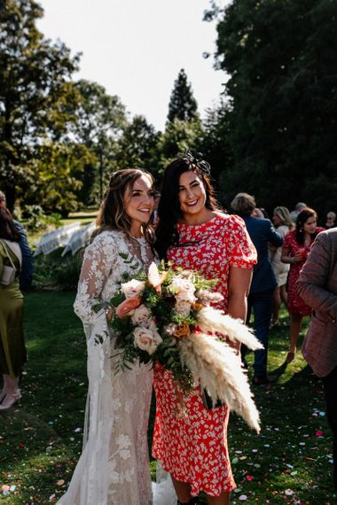 Bride and wedding guest portrait