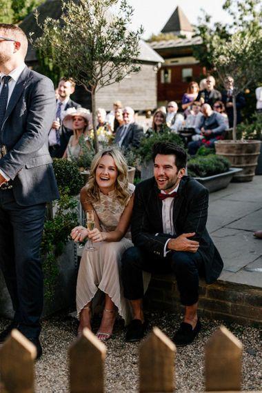 Wedding guests enjoying the speeches at Preston Court