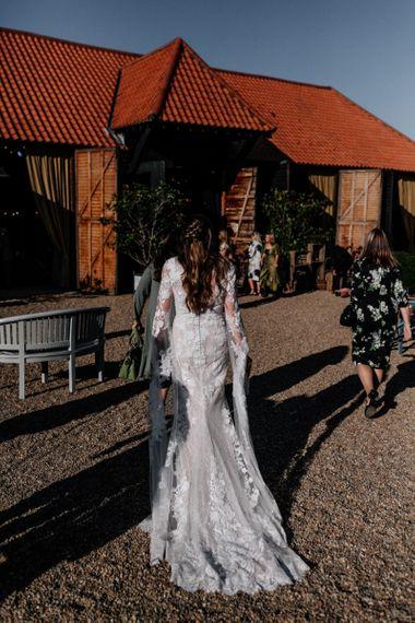 Bride in Pronovias wedding dress with Half up half down wedding hair