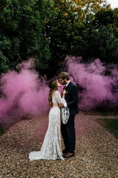 Bride and groom smoke bomb portrait at Preston Court