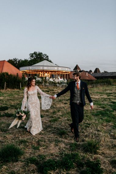 Bride and Groom portrait in front of the carousel at Preston Court wedding venue