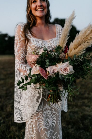 Wedding bouquet with pampas grass, anthuriums and roses