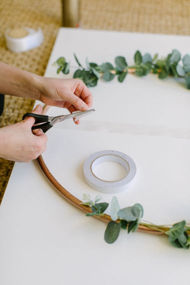 How to Make a Spray Painted Hula Hoop Table Plan for a Budget Wedding | Spray-painted Copper Hula Hoop with Ribbons and Greenery