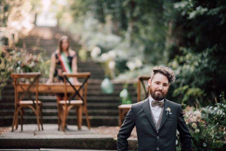 Groom sees bride in Rembo Styling dress at ceremony