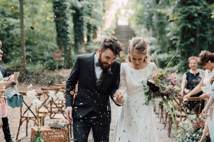 Confetti exit for bride in Rembo Styling wedding dress with groom