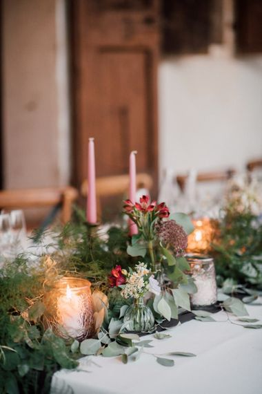 Wedding breakfast table decor with foliage and candles