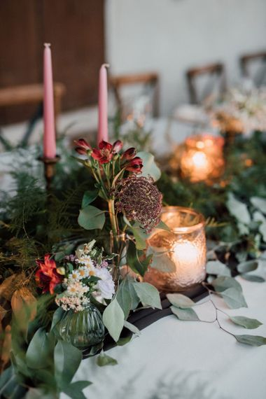 Wildflower wedding decor with romantic candles