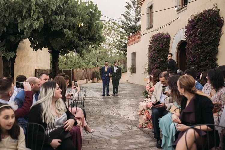 Outdoor Wedding Ceremony Groom Entrance with Groom in Forest Green Wedding Suit