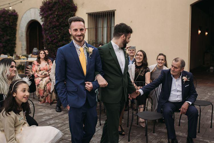 Outdoor Wedding Ceremony Groom Entrance in Forest Green Wedding Suit