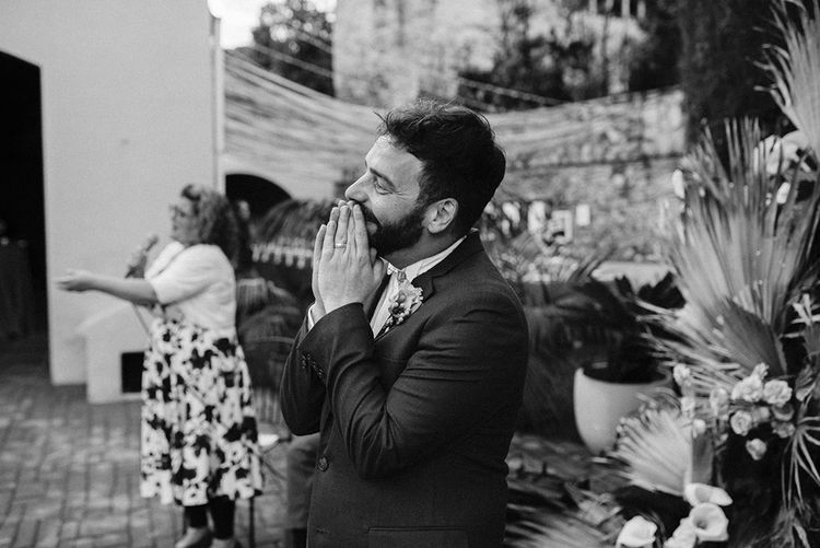 Happy Groom at the Altar