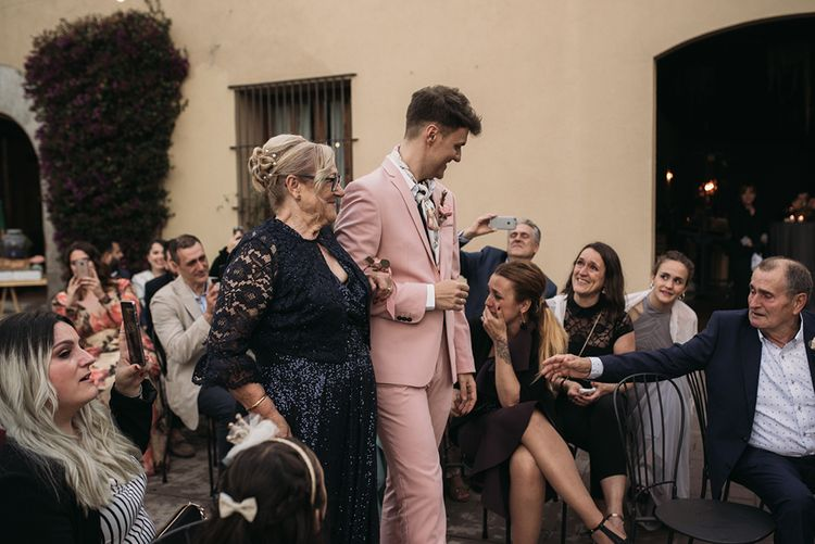 Wedding Ceremony Grooms Entrance with Groom in Pink Wedding Suit and Neck Tie