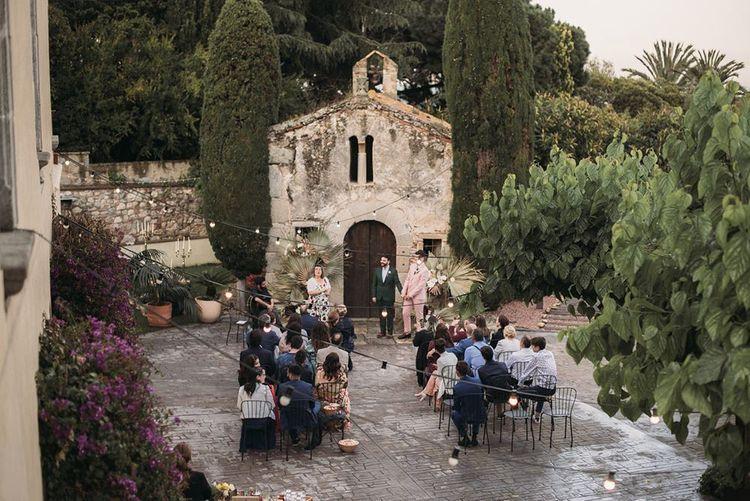 Intimate Barcelona Outdoor Wedding Ceremony with Festoon Lights
