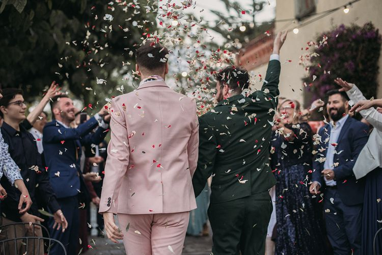Confetti Moment with Groom in Pink Wedding Suit and Green Wedding Suit