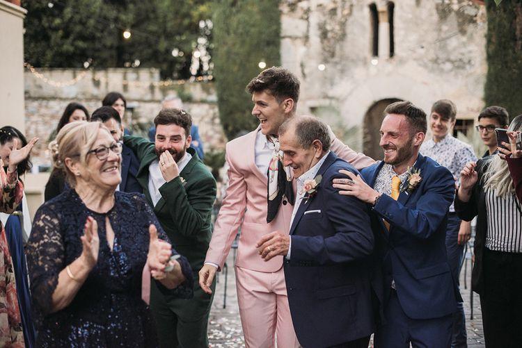 Wedding Guests Congratulating the Happy Couple