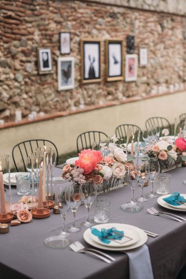 Coral Wedding Flower Centrepieces and Candle Light